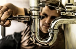 plumber fixing a pipe